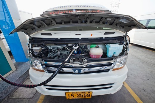 Stock Photo: 1606-187958 Thailand,LPG Gas Stand,Van Being Filled with LPG