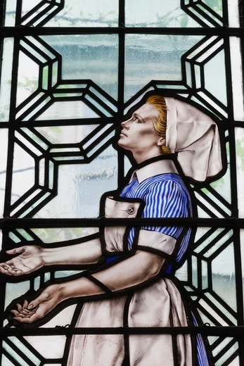 Stock Photo: 1606-188068 England,London,The City,St.Bartholomew the Less Chuch,Stained Glass Window depicting a Nurse