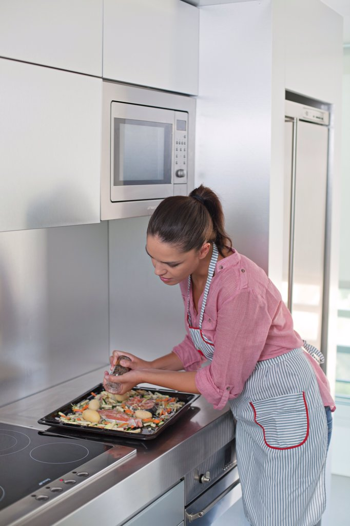 young woman in the kitchen : Stock Photo
