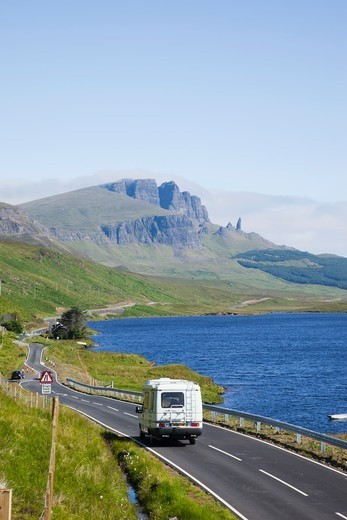 Stock Photo: 1606-189979 Scotland, Inner Hebrides, Isle of Skye, Camper on Road and Old Man of Storr Mountain