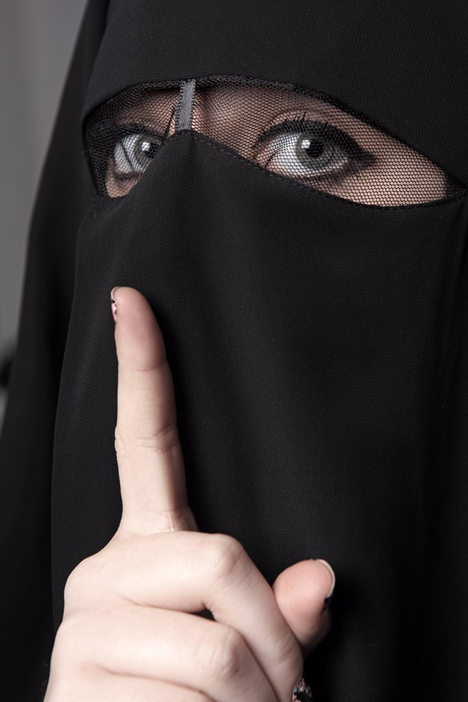 Muslim woman asking for silent : Stock Photo