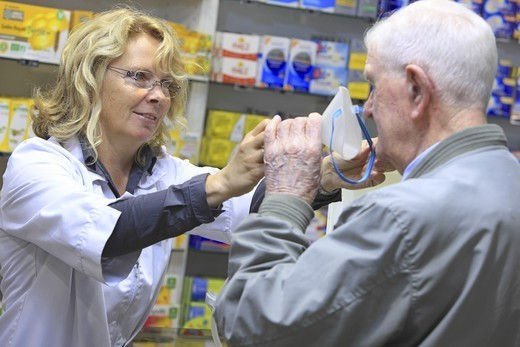 Stock Photo: 1606-194217 France, Drugstore, Pharmacist With A Customer