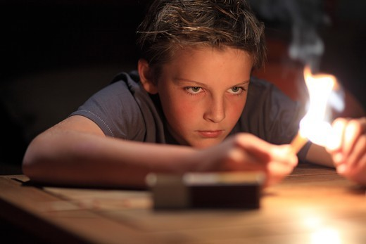 Stock Photo: 1606-197265 France, Young Boy And Fire