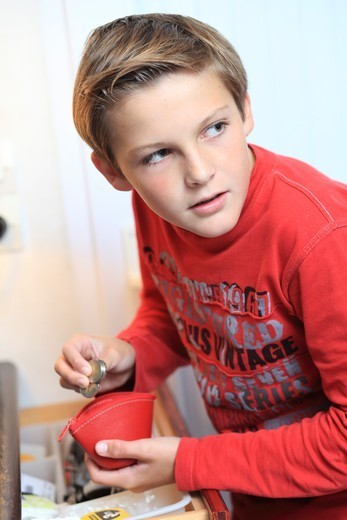 France, Young Boy And Money. : Stock Photo