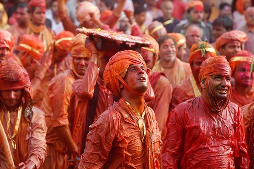 Barsana Villagers Celebrating Holi In Nandgaon, Taunting Nandgaon Villagers Who Throw Colored Fluids Over Them Nandgaon. India. : Stock Photo