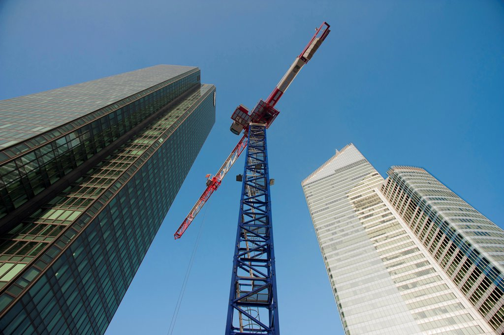Stock Photo: 1606-199883 Hauts-De-Seine, District La Defense, Crane Between  The Tower Suez Environnement, To The Left, And The Tower First, To The Right