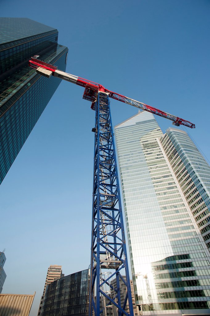 Stock Photo: 1606-199884 Hauts-De-Seine, District La Defense, Crane Between  The Tower Suez Environnement, To The Left, And The Tower First, To The Right