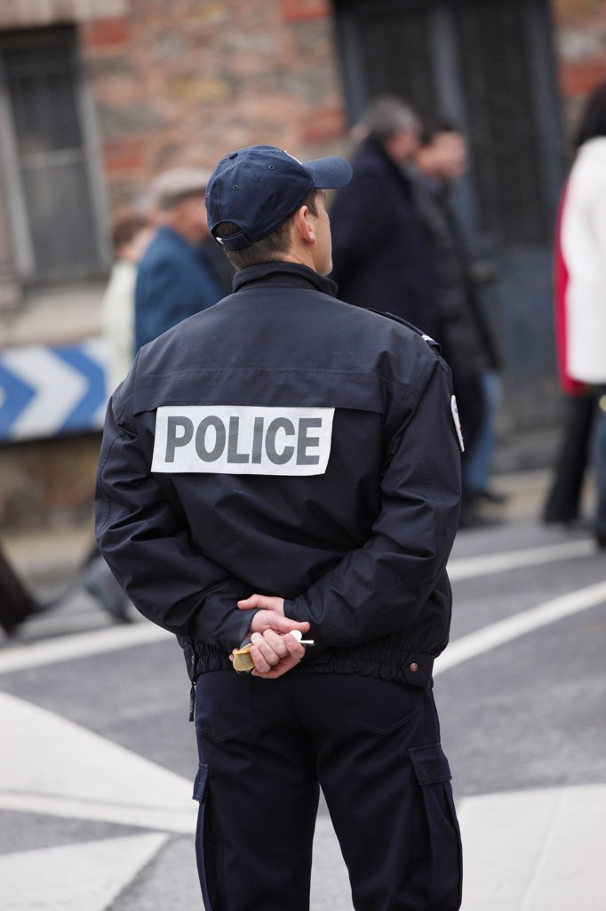 France. Seine Et Marne. Coulommiers. Policeman Watching People In The Street. : Stock Photo