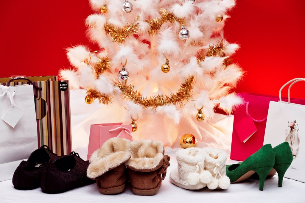 Stock Photo: 1606-201480 Still, Shoes And Gifts Beside A Christmas Tree