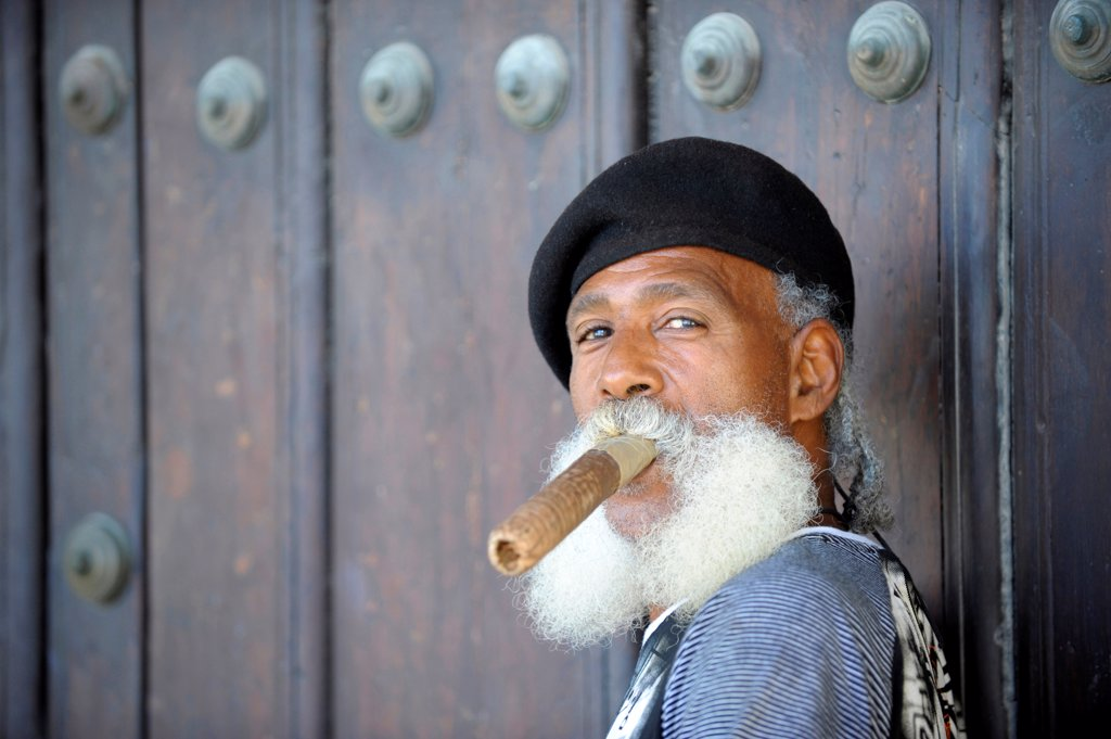 Stock Photo: 1606-201760 Senior Man In The Historic Centre Of Havana, With Cuban Cigar In The Mouth And Wearing A Black Beret, In Cuba