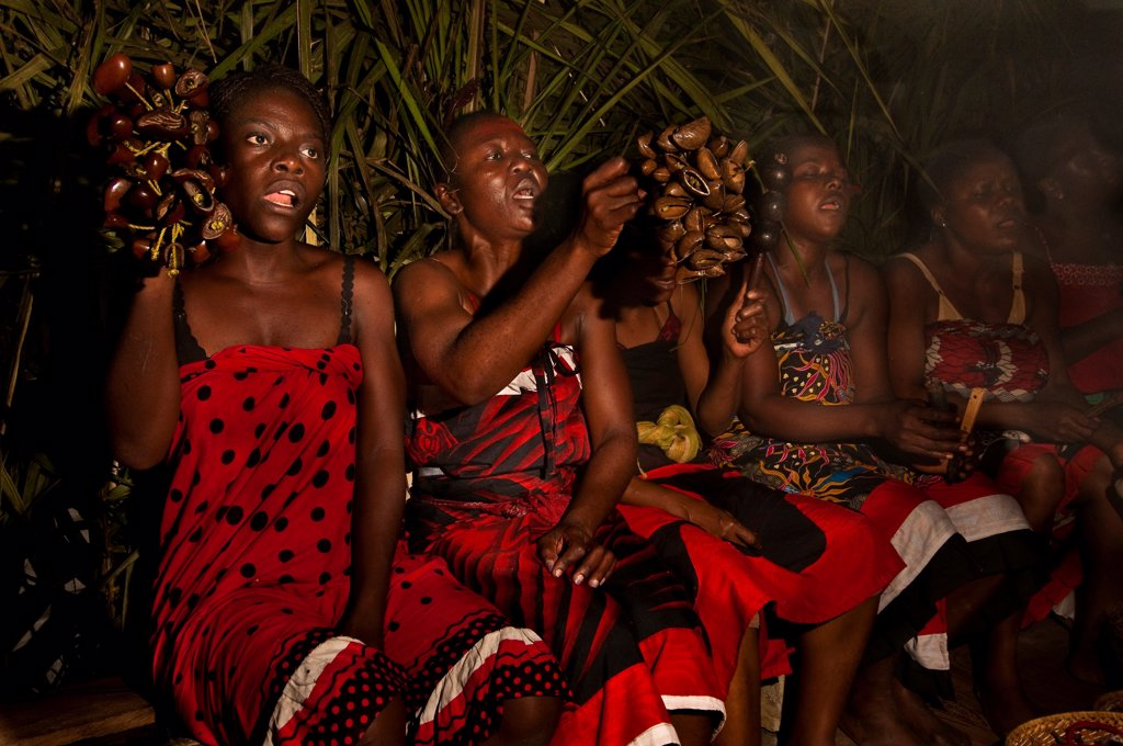 Africa, Gabon, Estuaire Region, Libreville Capital, Bwiti Ceremonies, Women Play Bitsanza (Tree Fruits Called 'Ongo') And Sing Until Dawn : Stock Photo