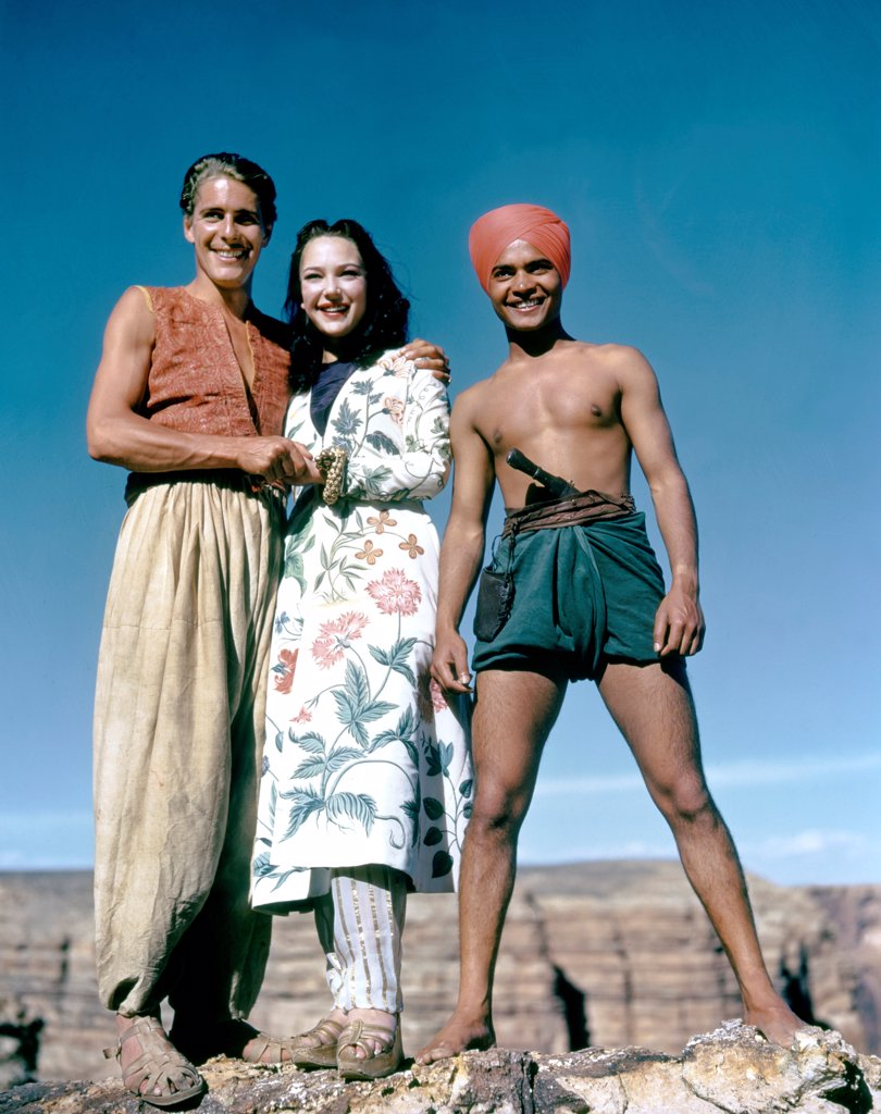 Stock Photo: 1606-203646 John Justin, June Duprez and Sabu, The Thief of Bagdad, 1940 directed by Ludwig Berger et Michael Powell (London Film Productions)