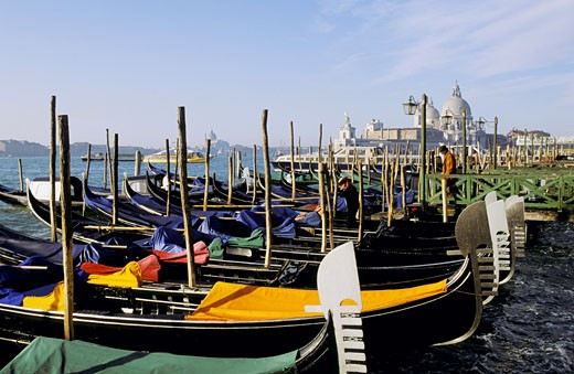 Italy, Venice, gondolas on canal, Salute church in background : Stock Photo
