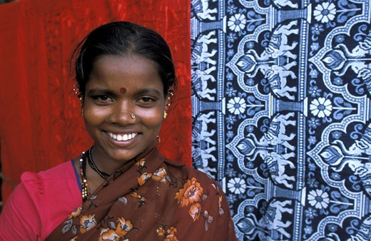 India, Kerala, Varkala, portrait of young smiling woman : Stock Photo