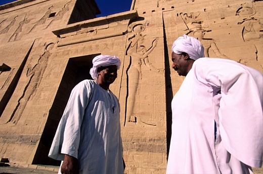 Stock Photo: 1606-23265 Egypt, Nile Valley, temple of Philae, (temple of Isis) entrance pylon designed with the low reliefs of Isis and Osiris