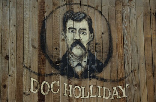 "USA, Arizona, Tombstone, ""Doc Holliday"" portrait painted on wooden wall : Stock Photo"