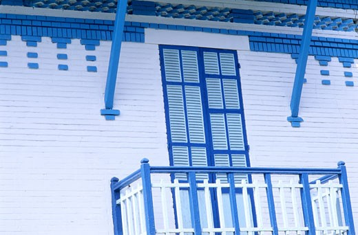 Stock Photo: 1606-27091 Egypt, Port Said, Port Fouad, blue and white house facade of the Suez Canal company, balcony, closed shutters