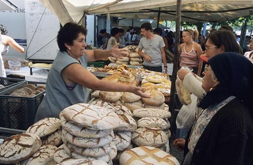 Portugal, Porto, market, woman selling bread, clients : Stock Photo