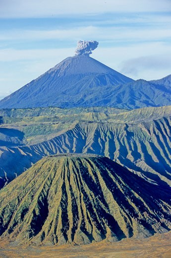Indonesia, Java, Mount Bromo and Tengger Caldeira, Semeru volcano erupting in the background : Stock Photo