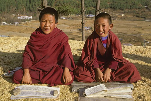 Bhutan, Thimphu, young Buddhist monks studying the scrriptures : Stock Photo