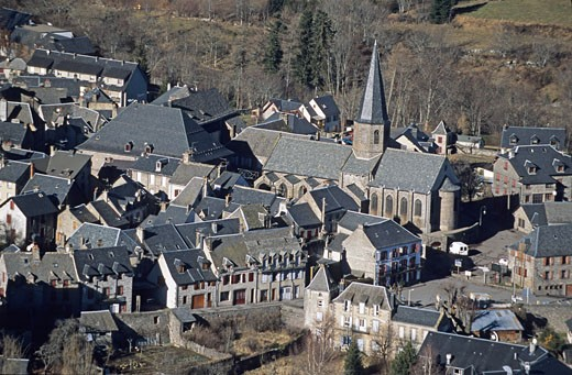 France, Auvergne, Puy-de-Dôme, Besse en Chandesse, aerial view of the church : Stock Photo