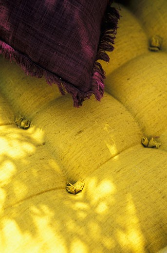Stock Photo: 1606-31588 Close up on yellow linen cushion, plum colour cushion