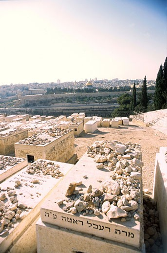 Israel, Jerusalem, overall view of the city from. Jewish cemetery, tombs in the foreground : Stock Photo