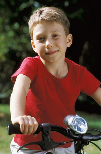 Portrait of a kid on a bike : Stock Photo