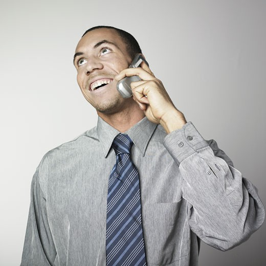 Stock Photo: 1606-33958 Portrait man smiling, on the phone