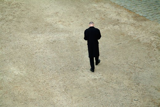 Man dressed in black, walking : Stock Photo