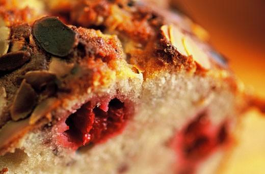 Cherry and almond fruitcake, cut slice : Stock Photo