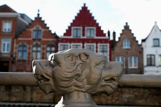 Belgium, Bruges, close-up on double head of a lion decorating the guardrail of the quay : Stock Photo
