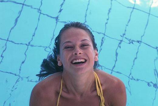 Woman in swimming pool : Stock Photo