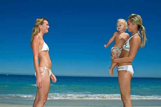 Stock Photo: 1606-42884 2 women and little boy on beach