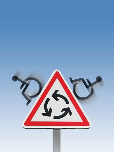 "Handicapped"" pictograms on roundabout roadsig : Stock Photo"