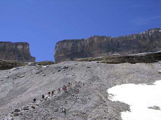 France, Midi-Pyrénées, Hautes-Pyrénées, Brèche de Roland, landscape with hikers : Stock Photo