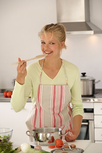 Young woman cooking : Stock Photo