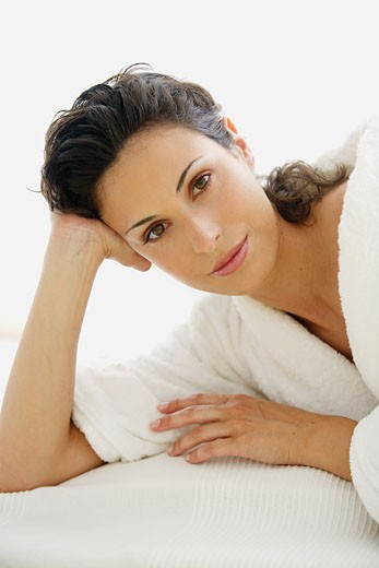 Stock Photo: 1606-49095 Portrait of woman with a bathrobe, looking at the camera