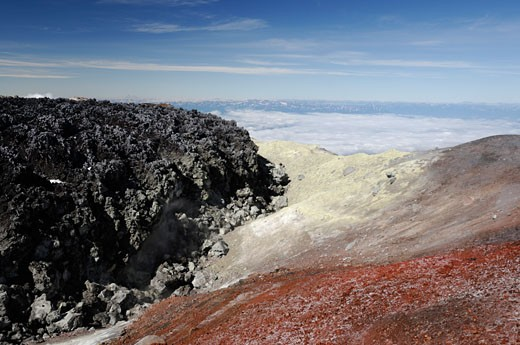 Russia, Siberia, Kamtchatka, Avachinsky volcano, lava, sulfur and red sediments in foreground : Stock Photo