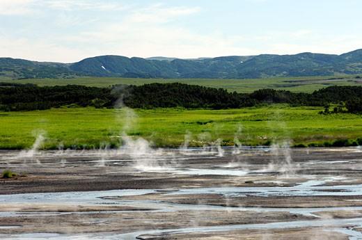 Russia, Siberia, Kamtchatka, Caldeira d'Uzon, smoke and gas near a lake : Stock Photo