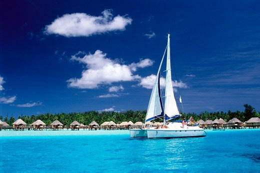 Stock Photo: 1606-55102 French Polynesia, Bora Bora, SPM hôtel, half overwater bungalows and catamaran