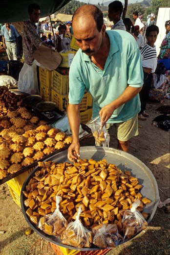 Tunisia, Tabarka, market place, pastries vendor : Stock Photo