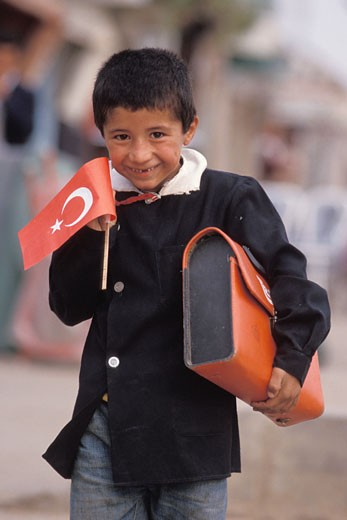 Turkey, Kurdistan, Diyarbakir, Republic feast, school boy in the street : Stock Photo