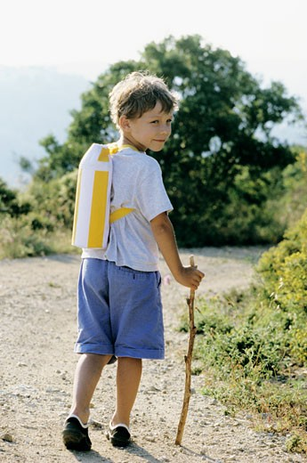 Little boy on a path, countryside : Stock Photo