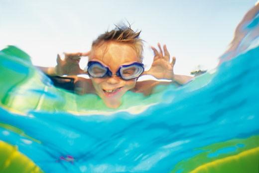 Little boy in a pool : Stock Photo