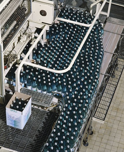 Stock Photo: 1606-70749 France, Auvergne, Allier, St Yorre mineral water plant, bottles in a box, indoors