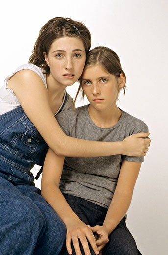 2 teenage girls looking sad : Stock Photo