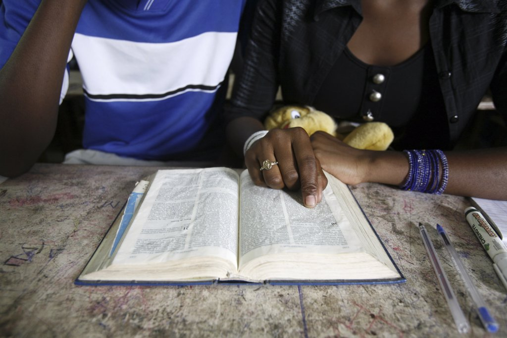 Stock Photo: 1606-72113 Congo, Brazzaville, Couple reading the bible