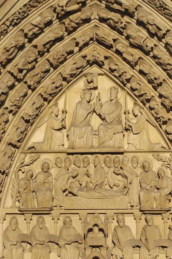 France, Paris, Notre Dame de Paris cathedral  Virgin's gate tympanum : Stock Photo