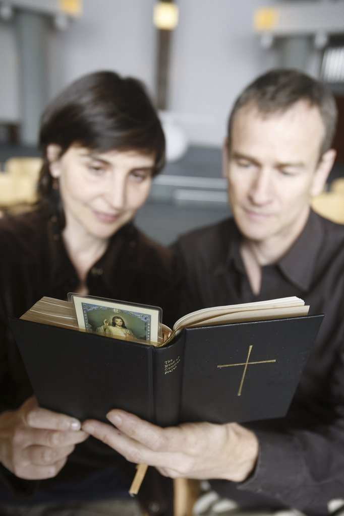 France, Paris, Couple reading the Bible : Stock Photo